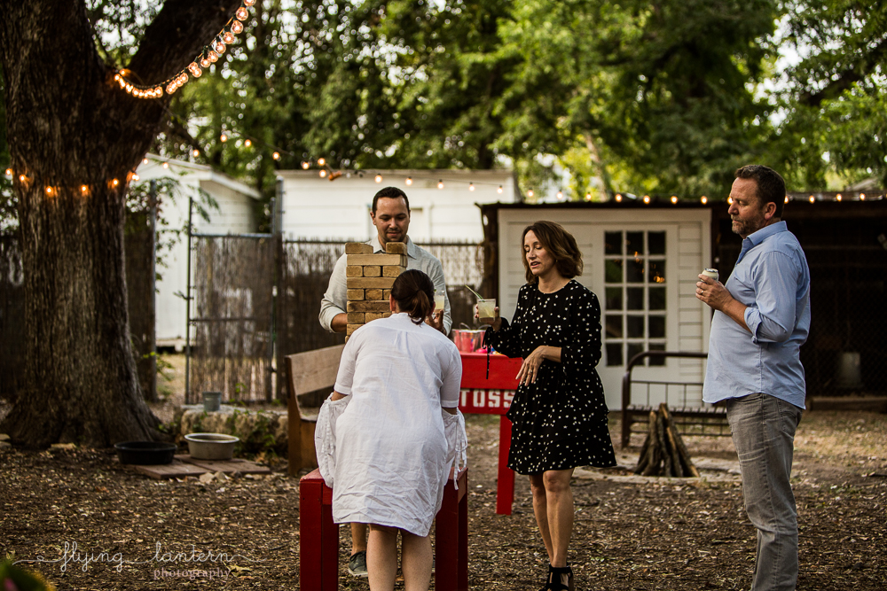 guests playing giant jenga at Eden East in Austin, TX. Photo by Erin Reas of Flying Lantern Photography
