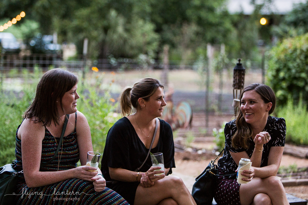Female guests laughing and talking at Wander/Gather event at Eden East. Event photography by Erin Reas of Flying Lantern Photography