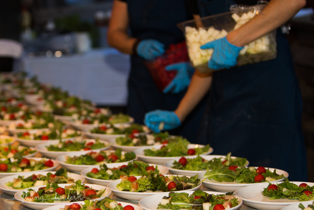 Salad being platted at Eden East. Event photography by Erin Reas of Flying Lantern Photography
