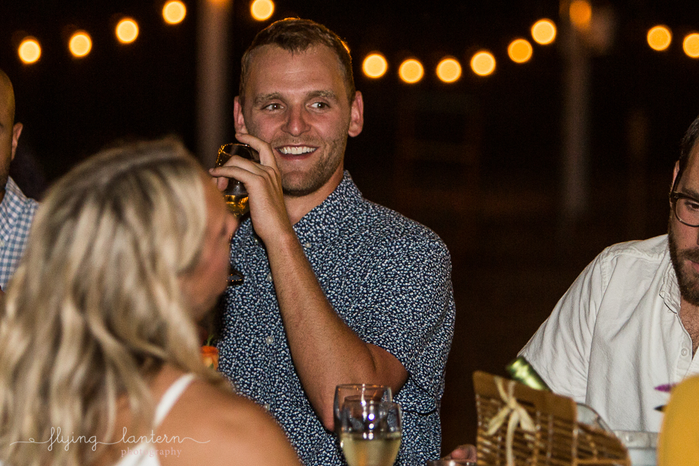 Male guest at dinner party smiling. Photo by Erin Reas of Flying Lantern Photography.