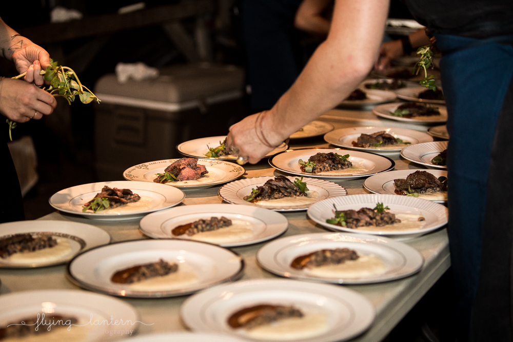Eden East chefs plating main course. Photo by Erin Reas of Flying Lantern Photography