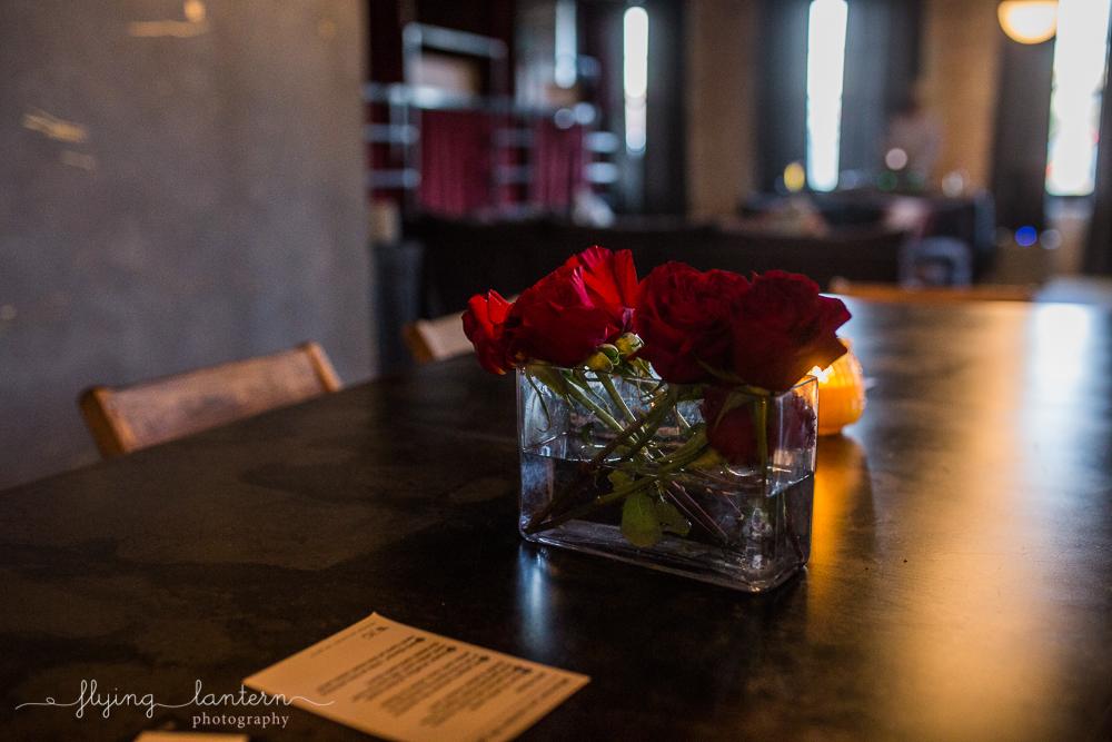 Flower arrangement on top of table.