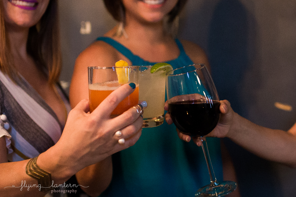 Women clinking glasses at party. Photo by Erin Reas of Flying Lantern Photography