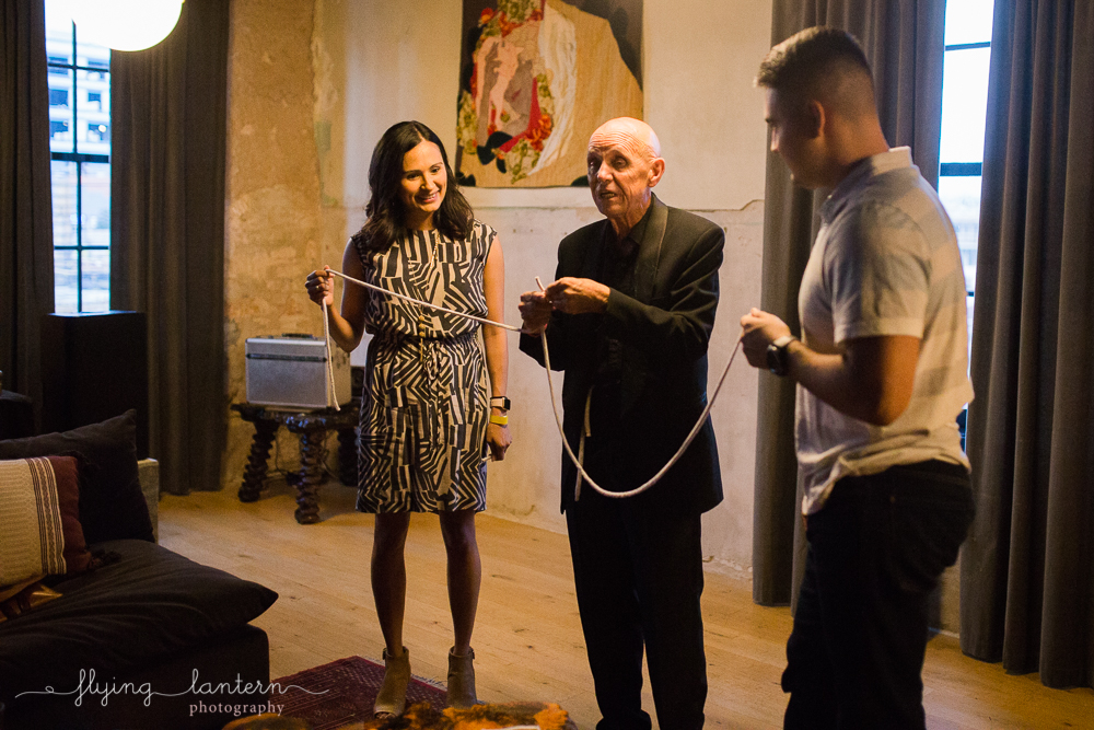 Magician performing rope trick during Wander/Gather event at Native Hostel. Photo by Erin Reas of Flying Lantern Photography