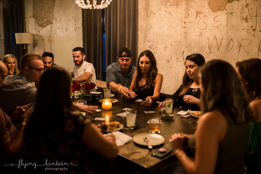 Friends around table playing Cards Against Humanity at Native Hostel. Photo by Erin Reas of Flying Lantern Photography