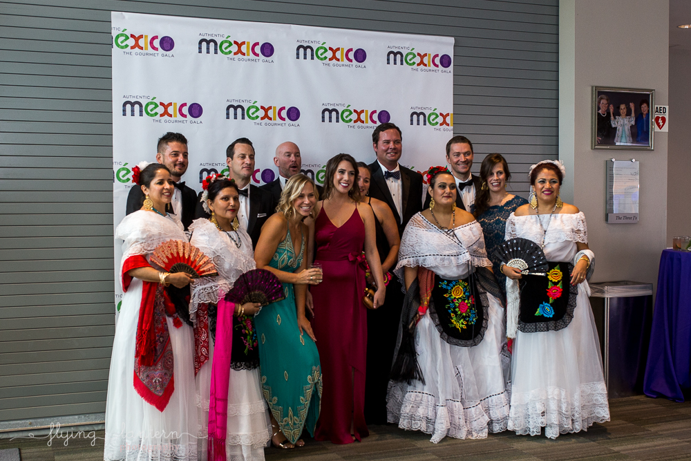 Fiesta dancers posing with guests at the Authentic Mexico Gourmet Gala. Event Photography by Erin Reas.