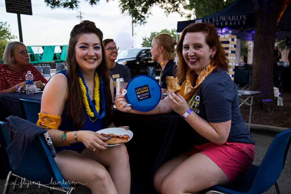 Alumni at Hillfest 2018 on St. Edward's University campus. Event photography by Erin Reas of Flying Lantern Photography