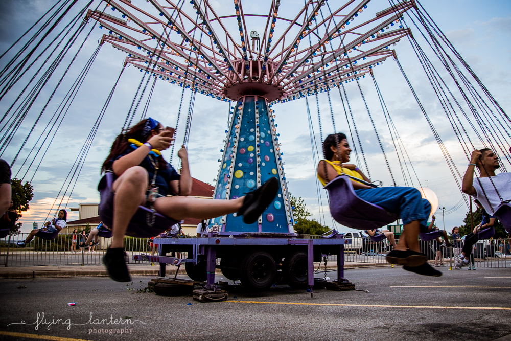 Carnival swing ride at Hillfest 2018 on St. Edward's University campus. Event photography by Erin Reas of Flying Lantern Photography