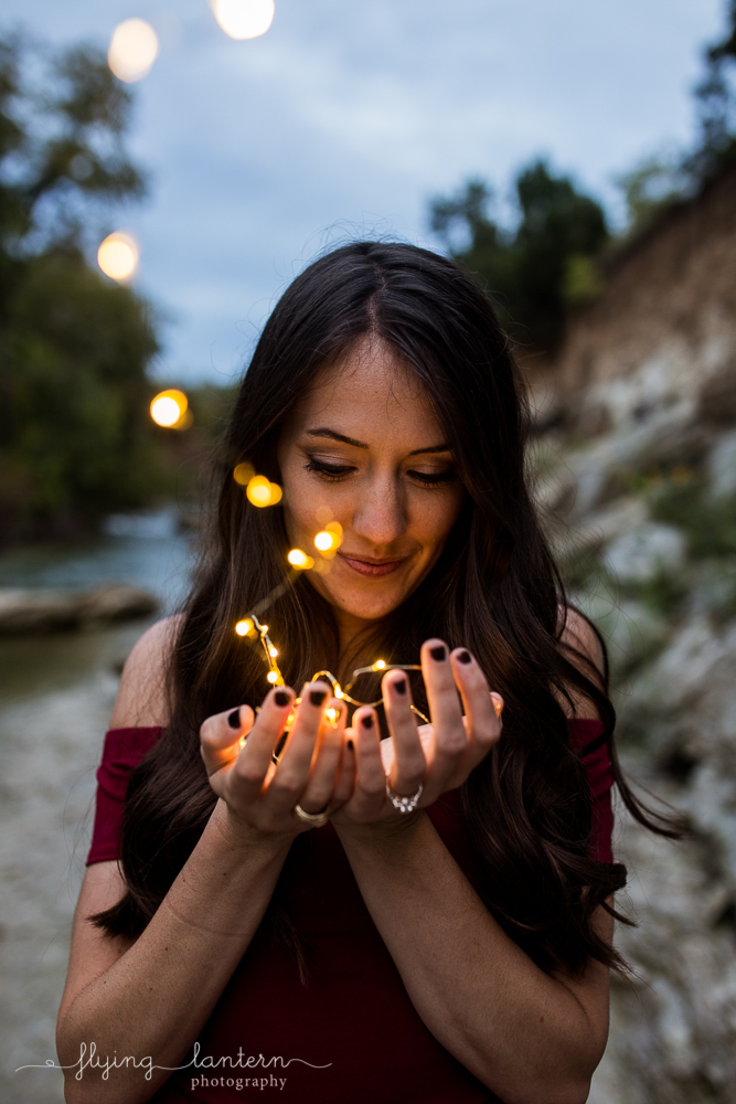 Girl with fairy lights at Walnut Creek in Austin Texas. Photo by Erin Reas of Flying Lantern Photography