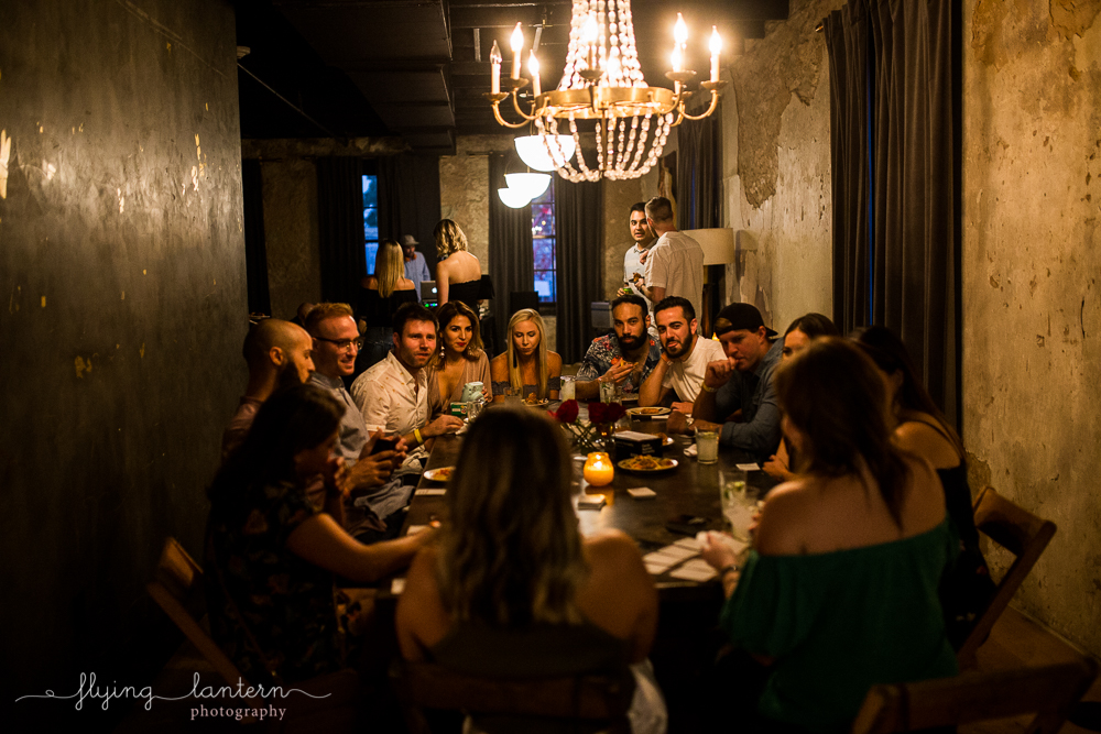 wander/gather event at native hostel. guests around dinner table. event photography by erin reason of flying lantern photography