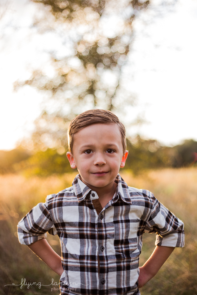 five year old boy with hands on waist during family session. photo by erin reas of flying lantern photography