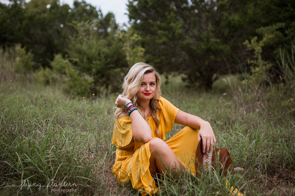 girl in a yellow dress boho styled senior. high school senior photography by erin reas of flying lantern photography in austin, tx