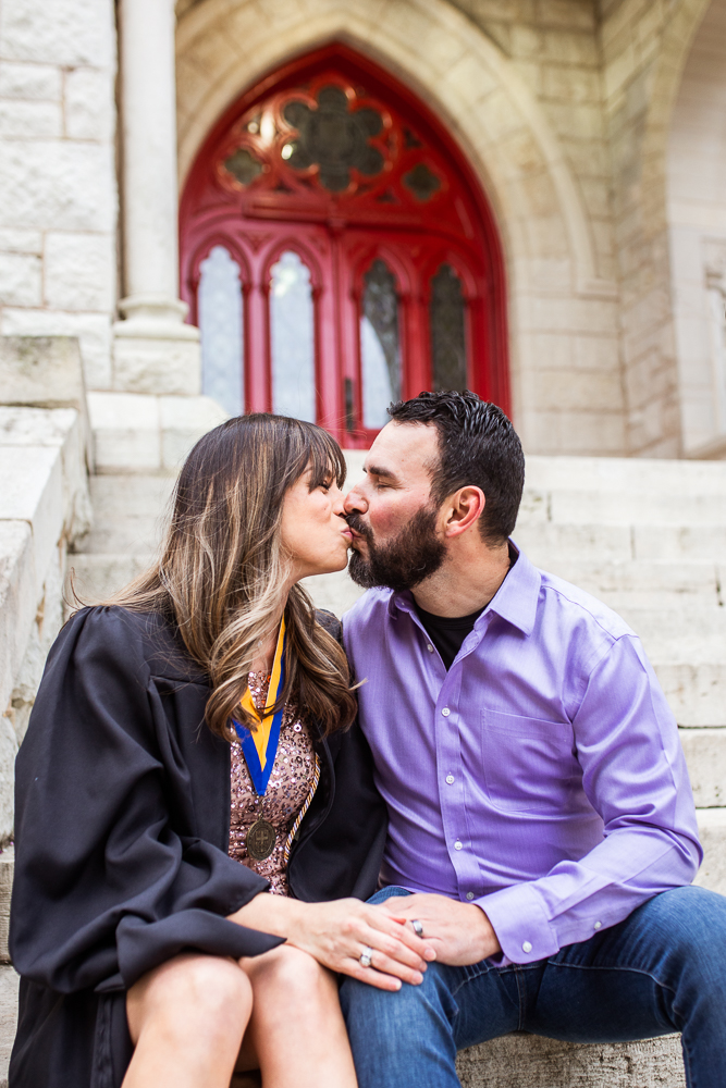 Couples portrait at St. Edward's University in Austin, TX cuddling on steps of Main Building. Senior portraits by Erin Reas of Flying Lantern Photography