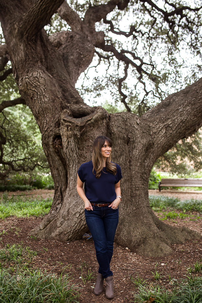 Graduation portrait at St. Edward's University standing in front of Sorin Oak. Senior portraits by Erin Reas of Flying Lantern Photography