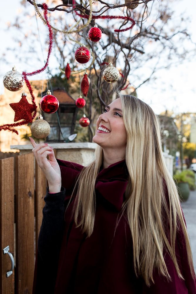 Girl lifestyle portrait playing with ornaments in Downtown Buda. Photo by Erin Reas of Flying Lantern Photography
