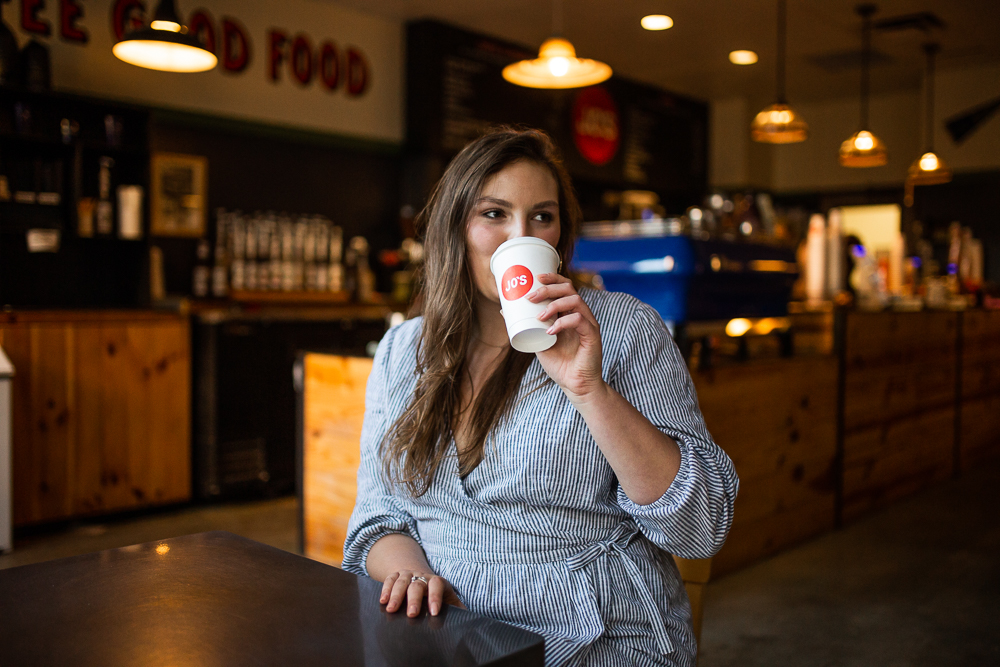 Female college student drinking coffee in Jo's coffee on St. Edward's University in Austin, TX. Photo by Erin Reas senior photographer