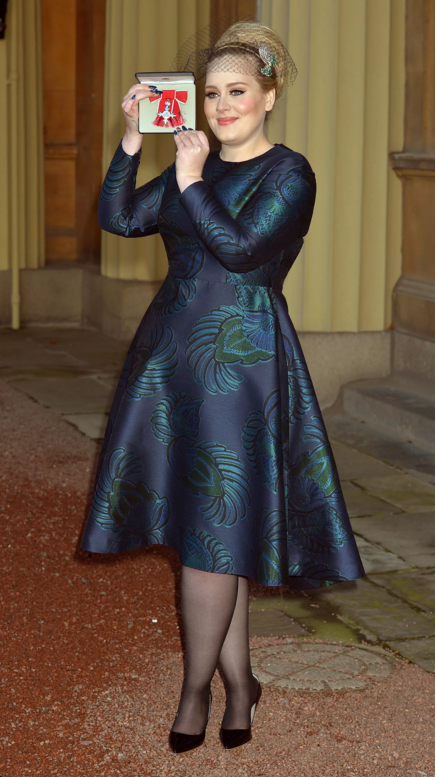 Wearing a Stella McCartney dress while receiving an MBE at Buckingham Palace.