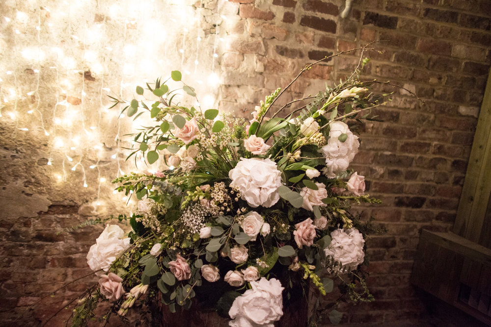 Barrel floral displays at The Normans. Photo by www.inspirephotos.co.uk