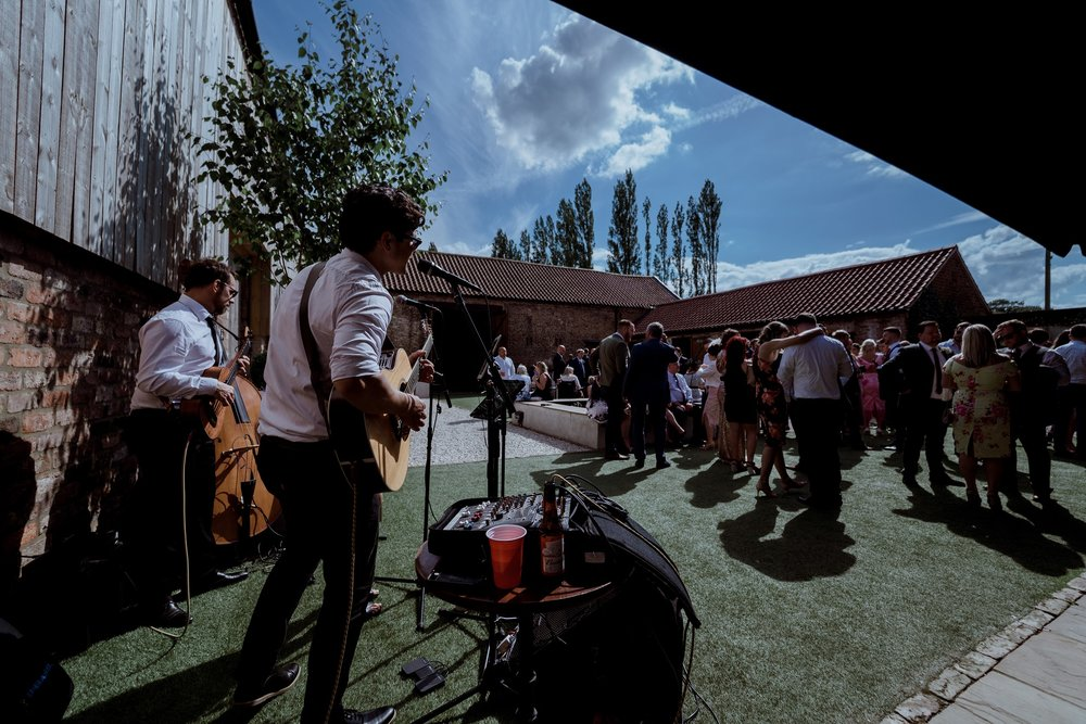 Party time in The Normans courtyard. Photo by www.sevenpoints.uk