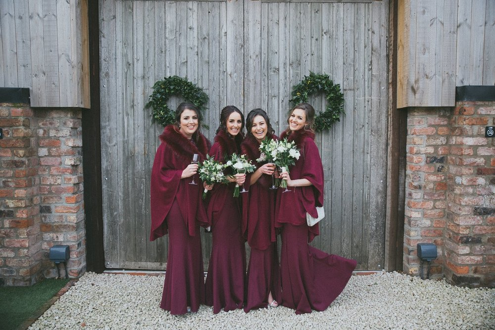 Winter bridesmaids at The Normans Photo by www.cliquevisuals.co.uk