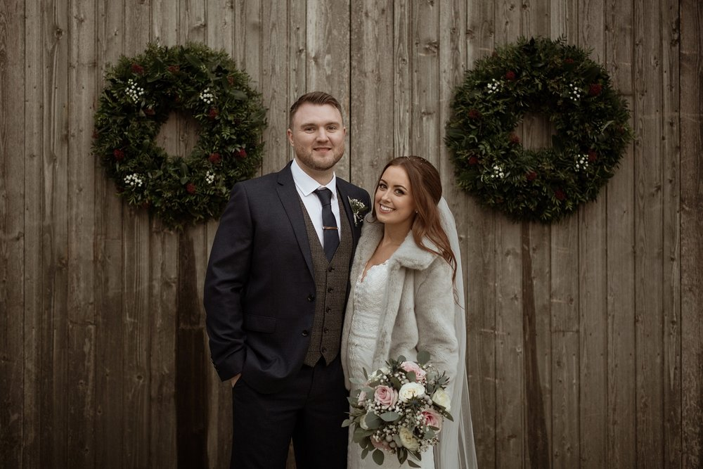 Christmas couple at The Normans Photo by Luke Bell Photography