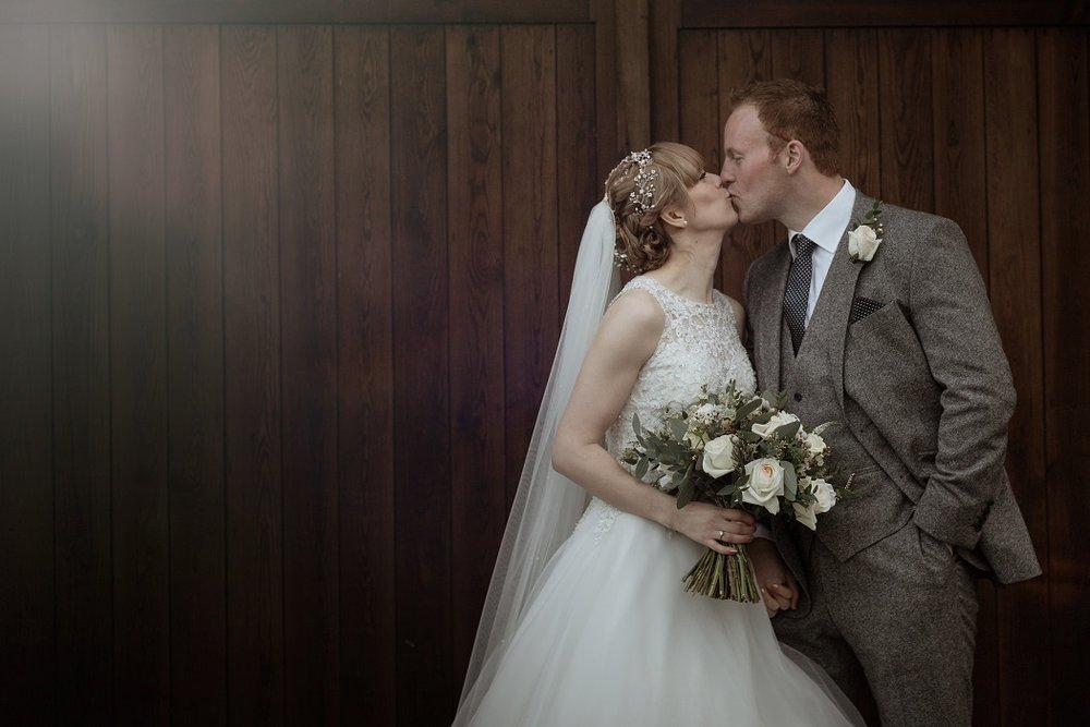 Just Wed Kiss at The Normans Photo by Luke Bell