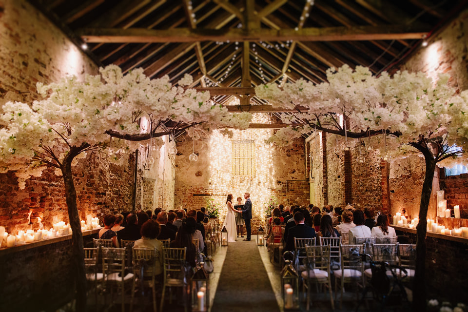 Wed beneath the blossom at The Normans Photo by CJ Rodgers Photography