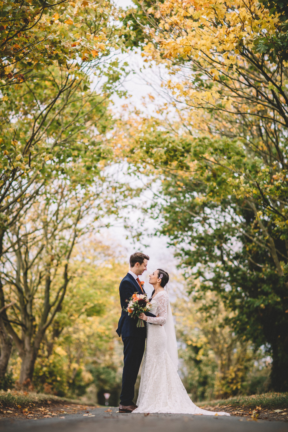 Rachel & Andrew by Lumiere - an embrace amid the autumn hues.jpg