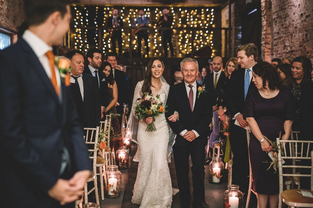Rachel & Andrew by Lumiere Photographic - the bride walks down the aisle.jpg