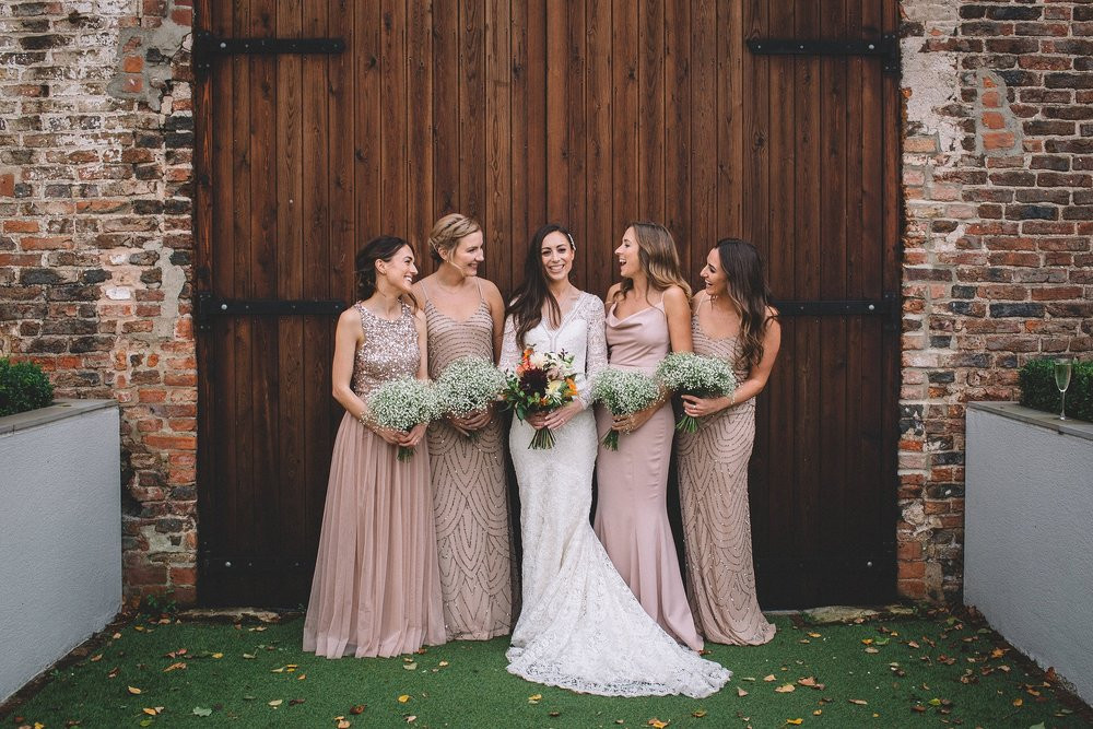 Rachel & Andrew by Lumiere Photographic - Rachel and her bridesmaids in the Courtyard.jpg