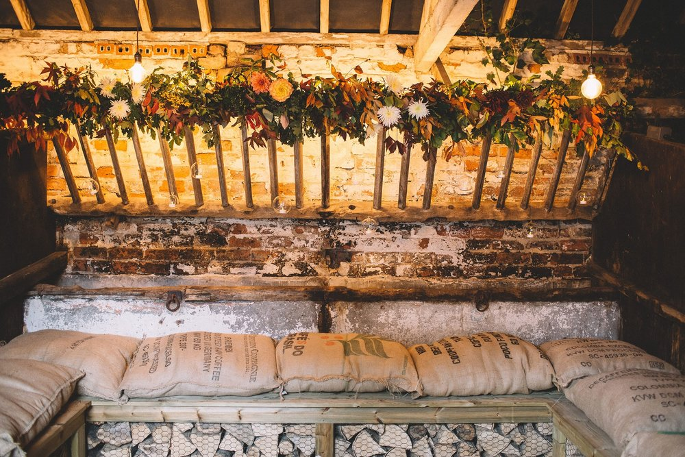 Rachel & Andrew by Lumiere Photographic - the Cow Stalls bedecked in flowers by Clock Dandelion.jpg