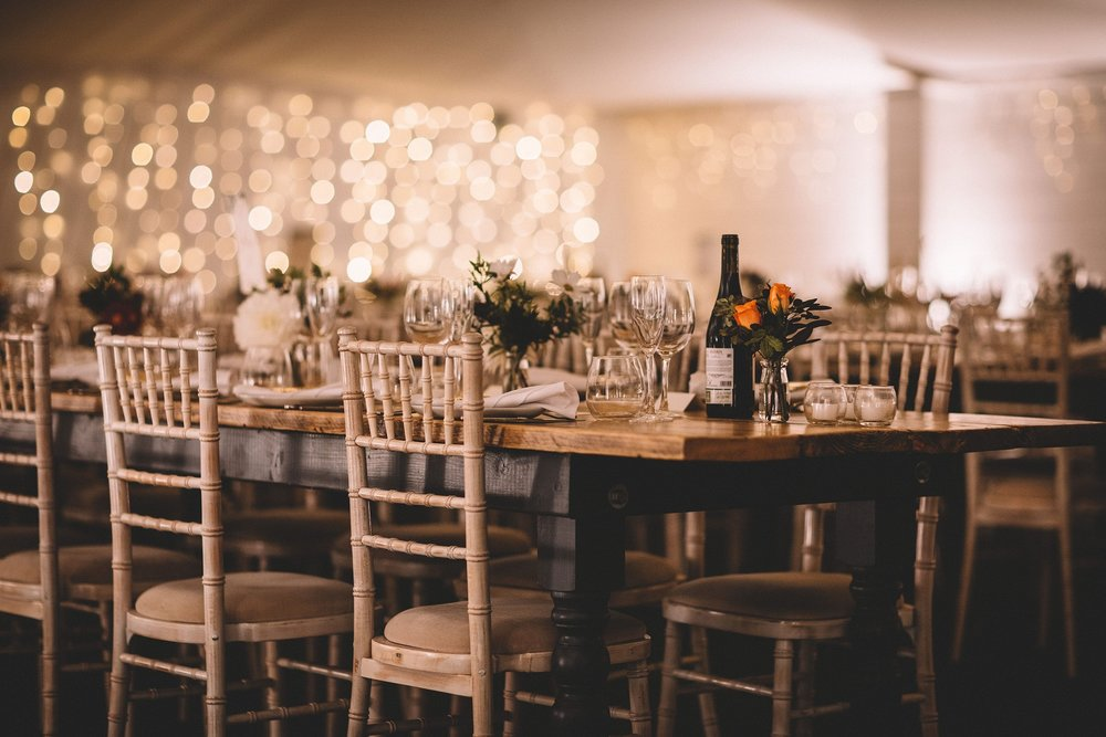 Rachel & Andrew by Lumiere Photographic - Long rustic tables in the Grain Shed.jpg