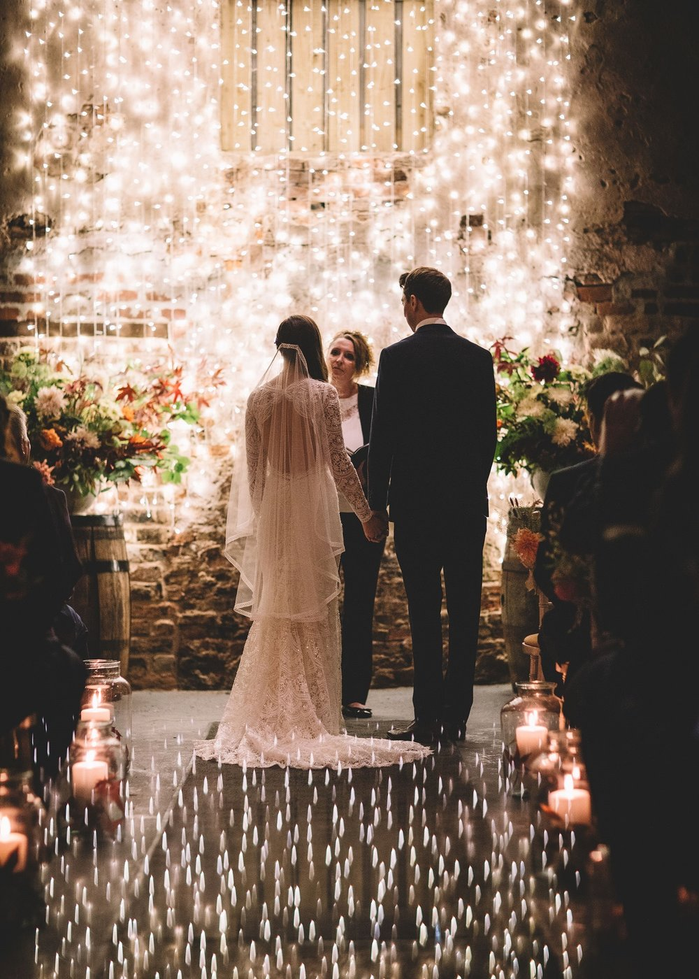 Rachel & Andrew by Lumiere Photographic - bride and groom sparkling in the Ceremony Barn.jpg