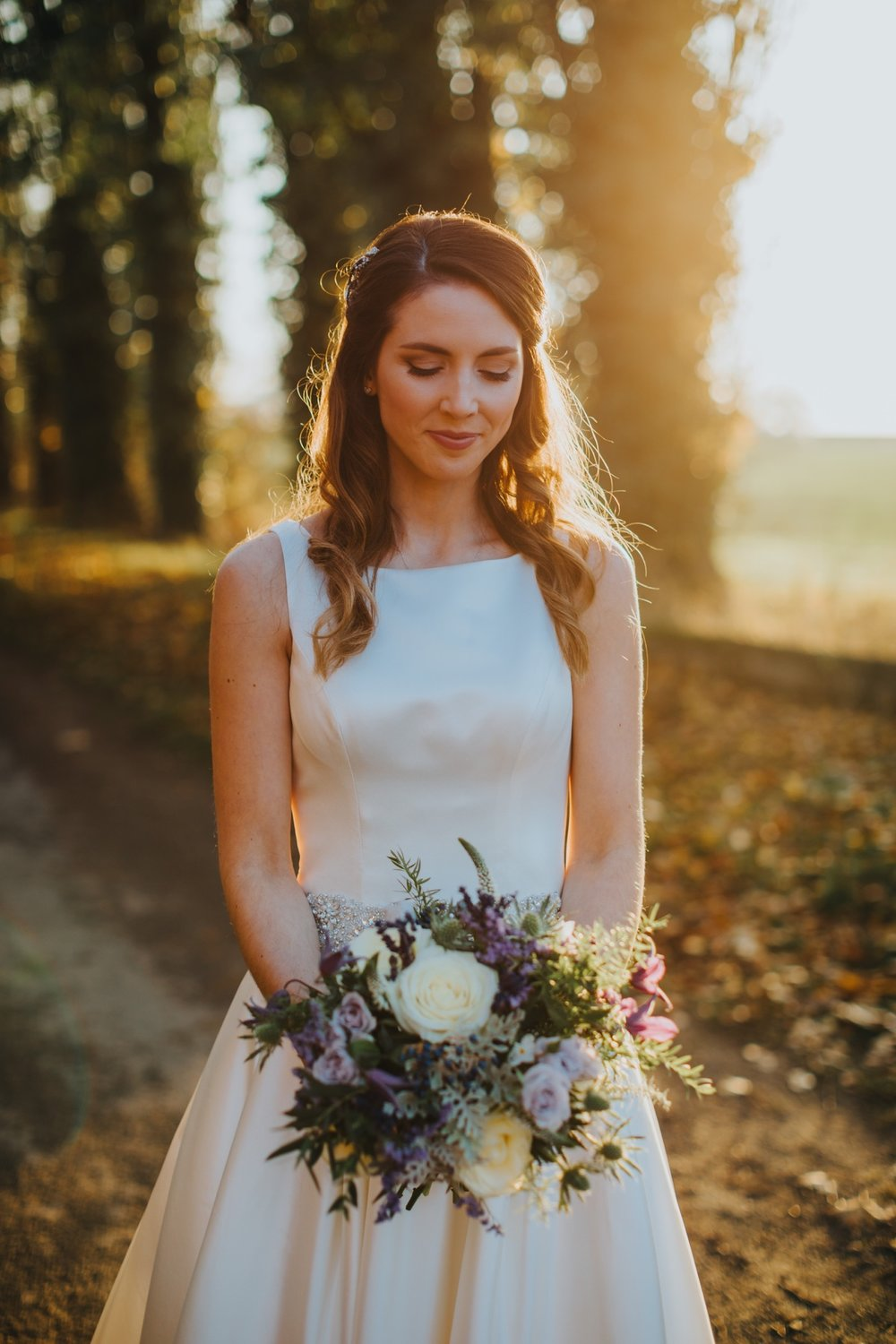 Bride Holly takes a moment in the autumn light.jpg