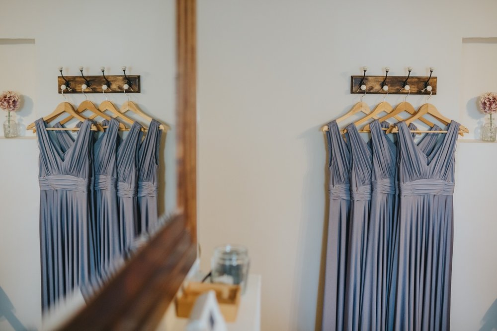 Bridesmaids dresses hanging up in The Cottage.jpg