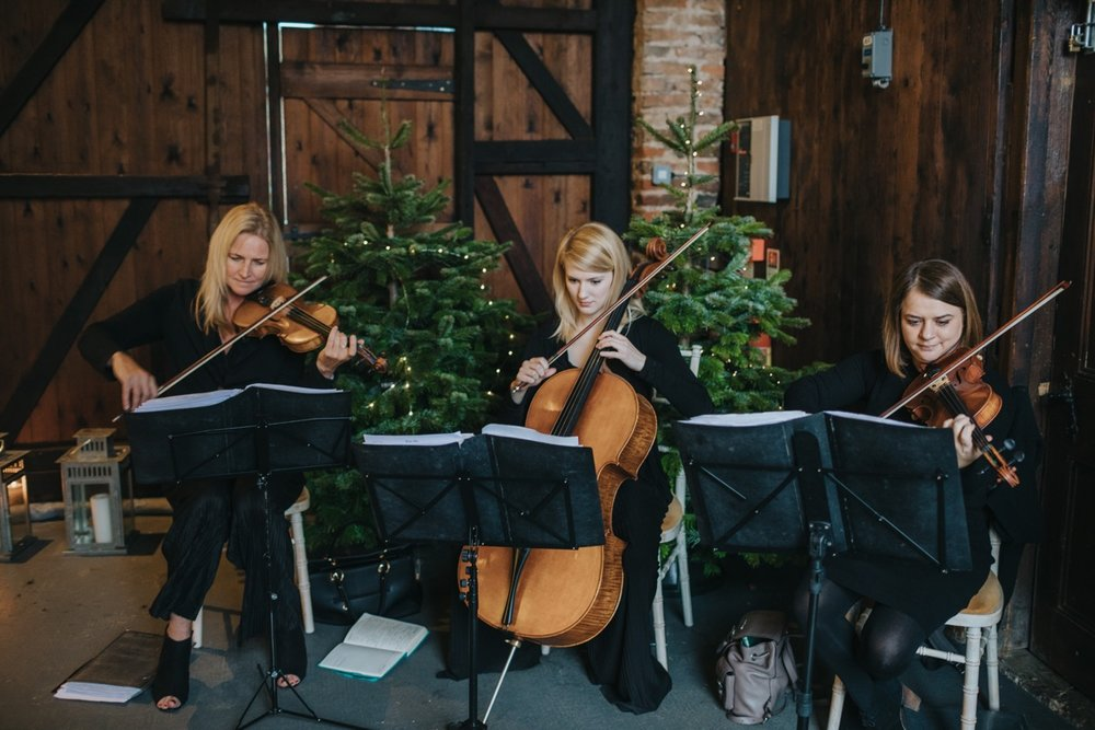 Simply Strings were on hand to greet guests as they entered the Ceremony Barn. Photo by Bloom Weddings