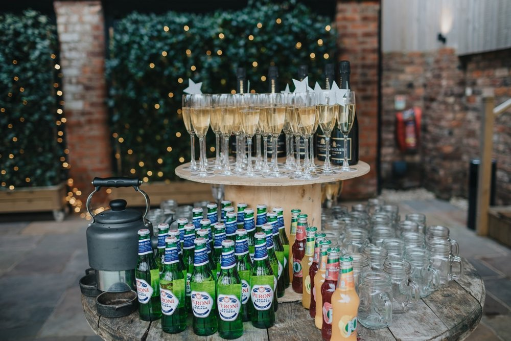 Bubbly and beer awaited thirsty guests outside in the Courtyard. Photo by Bloom Weddings