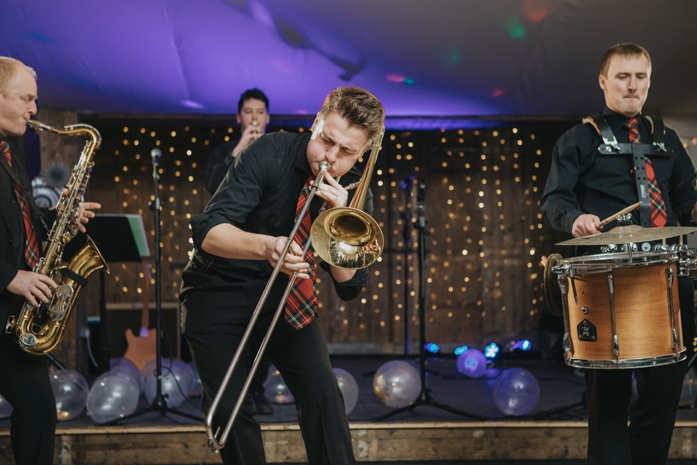 New York Brass Band set the night alight at The Normans. Photo by Bloom Weddings