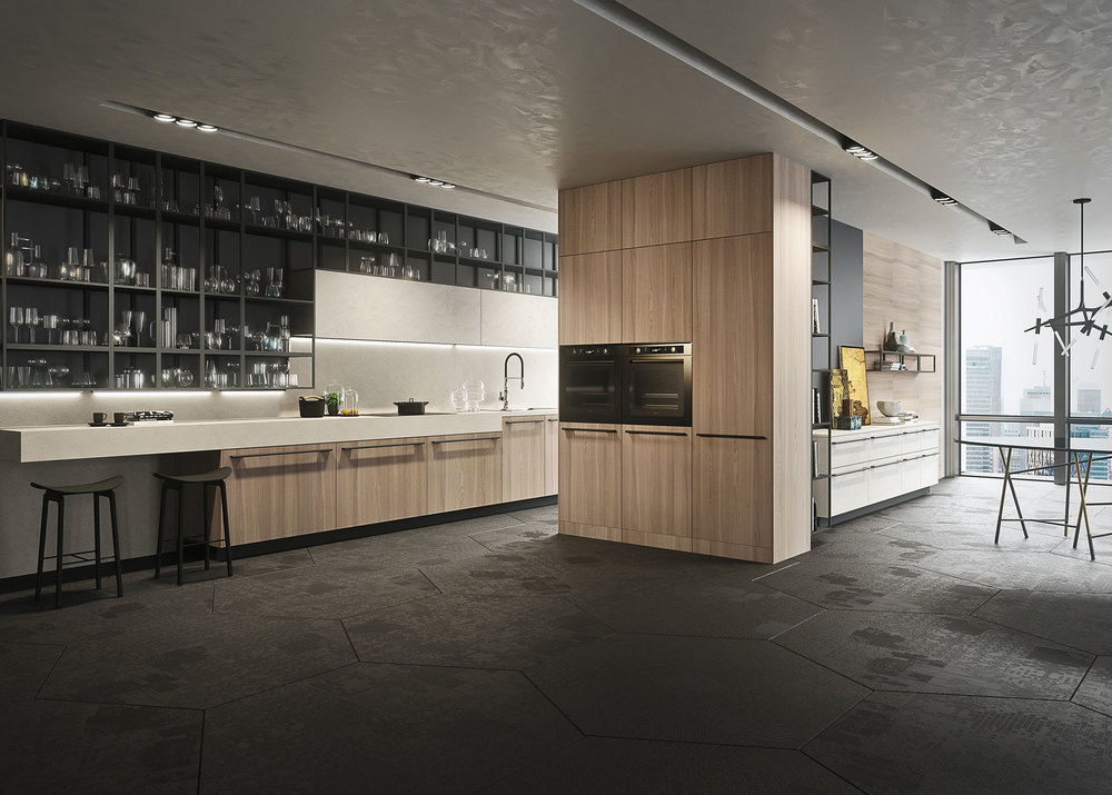 Opera presented with Cenere melamine faced Olmo Natural wood. Kitchen unit 17 cm high and shelf of Cenere melamine faced laminate. Living area with paneling of Platino gray lacquered aluminum.