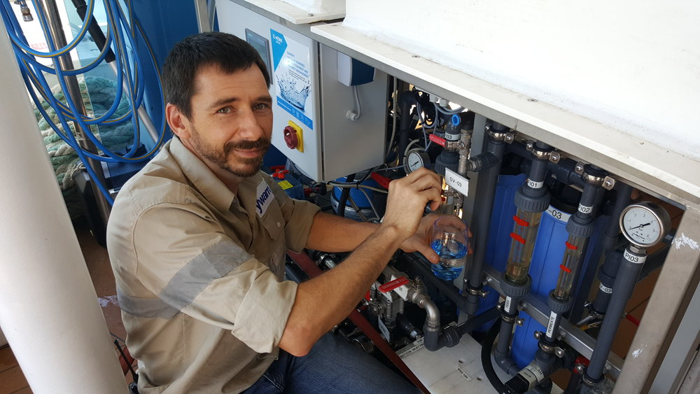 Derik van Staden, the ship's technician, tests the reverse osmosis unit we installed on MV YWAM PNG.  It is currently being used to provide the patients and volunteers on the ship with fresh drinking water. In the future it will also be used for training purposes.                                                  PHOTO: YWAM