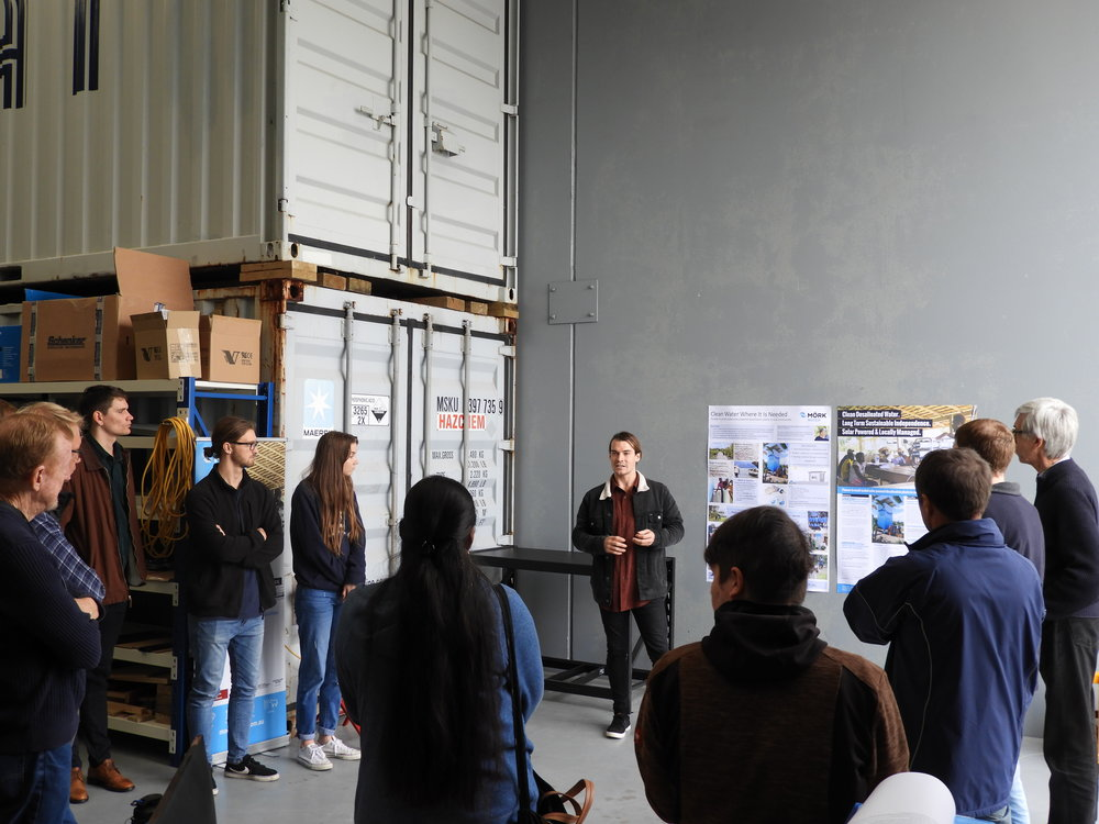 The students learn about the installation they will soon take part in.