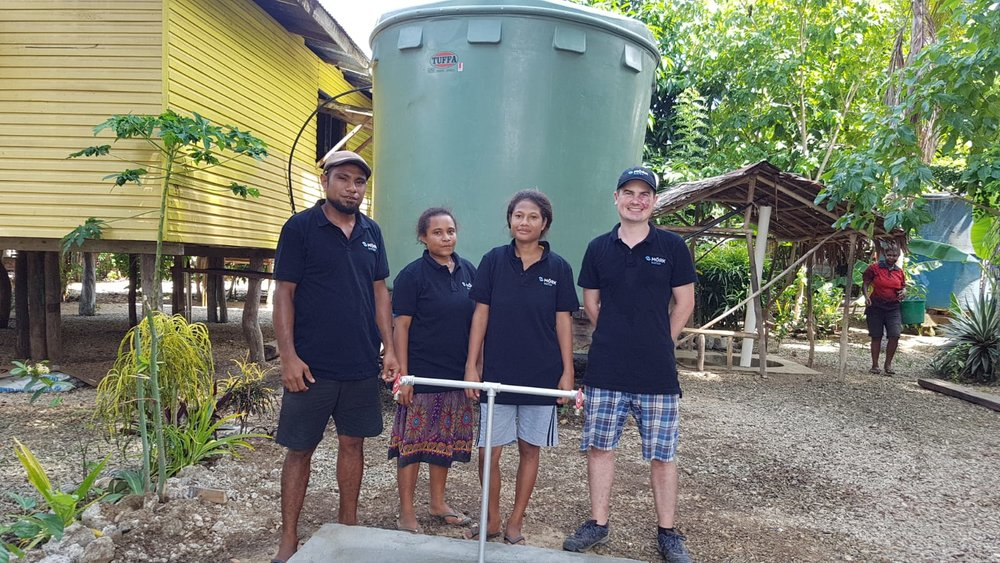 Local people with Daniel Wagler, Moerk Water, after completing training to operate the solar powered water purification technology. .jpg