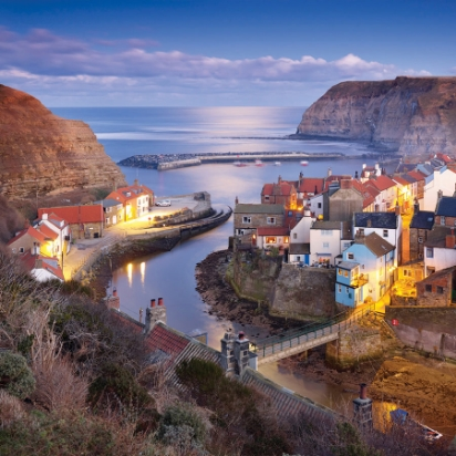 BEST PICTURESQUE VILLAGE: STAITHES, NORTH YORKS FIND IT NESTLED IN A TINY COVE IN SCARBOROUGH, THIS IMAGE BY JOE CORNISH GALLERIES SAYS IT ALL.