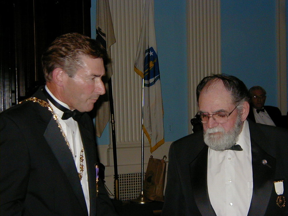 Illustrious Robert Clarke, 33°, (left) presents Meritorious Service Award to Brother William Donovan, 32°, Past Thrice Potent Master of Merrimack Valley Lodge of Perfection. October 9, 2003.