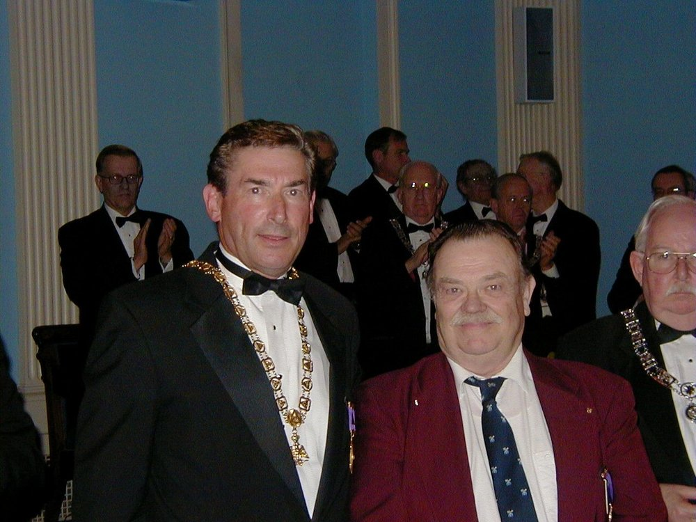 Illustrious Robert Clarke, 33°, (left) presents Meritorious Service Award to Brother Robert O. Hinckley, 32°, Past Thrice Potent Master of Lawrence Lodge of Perfection, at the inaugural meeting of the Valley of the Merrimack on October 9, 2003