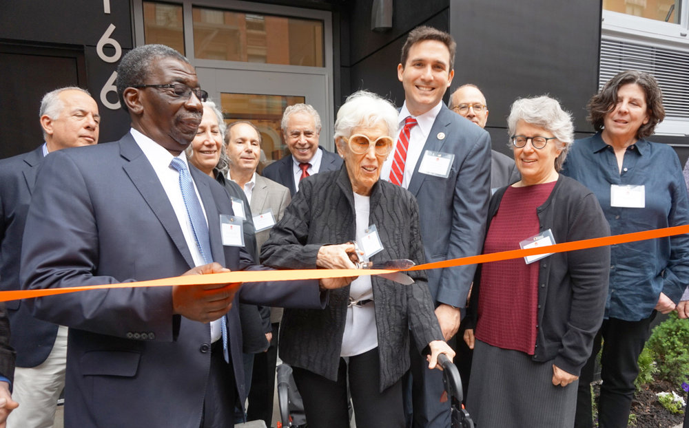 Howard Amron's widow, Joan Amron cuts the ribbon for the Howard Amron House with Council Ben Kallos, Urban Pathways CEO Fred Shack, family and board members looking on.