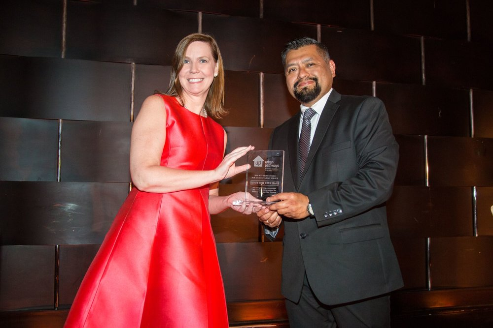Suzanne accepting the Way Home Award for Humanitarian Service given by Ivan Shapiro's Program Director Marcos Campos.