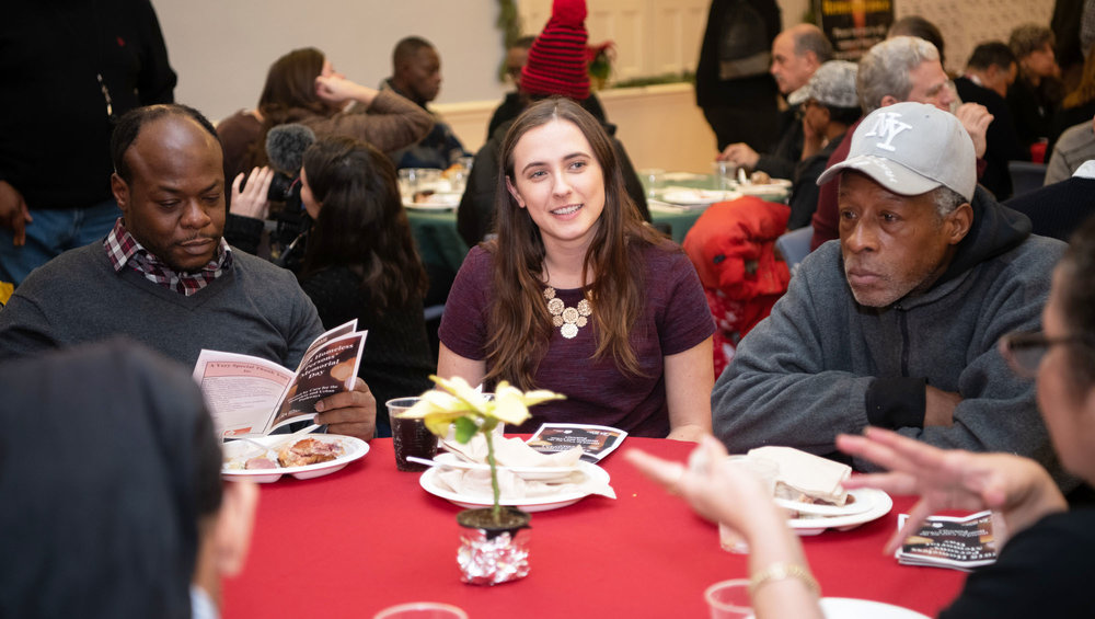Sophia with clients at the Homeless Memorial Service last year.