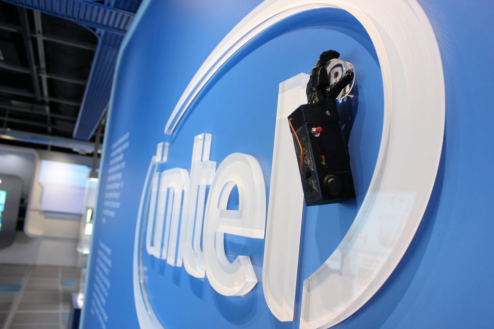 intel logo with robotic hand
