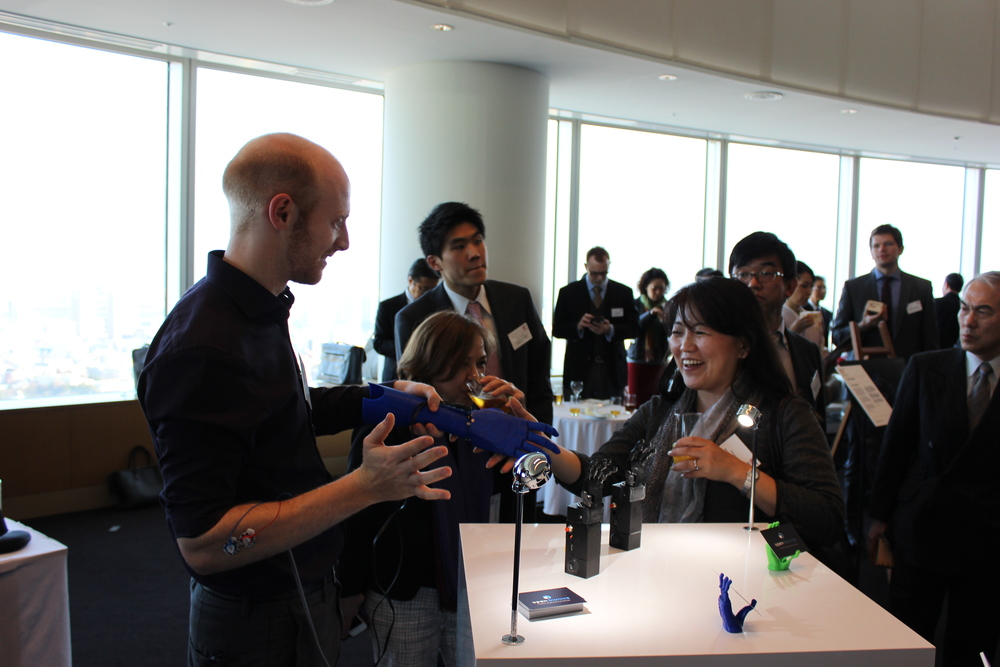 Joel Gibbard demonstrating bionic hand in Japan
